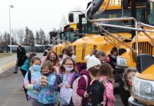 Students at Madison-Grant United School Corporation in Fairmount, Indiana load into school buses at school dismissal. Assistant Superintendent Steve Vore and Superintendent Dr. Scott Deetz oversee students transfers at dismissal in a team effort. (Photo courtesy of Madison-Grant United School Corporation, taken by teacher Joe Deckard.)
