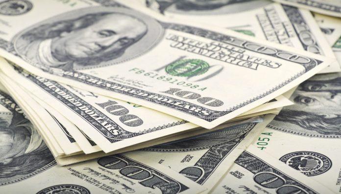 Many dollar banks note on money background