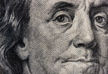 Closeup of Ben Franklin on a one hundred dollar bill for background IV