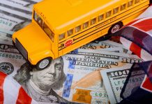 toy yellow school bus , US flag and dollar cash money
