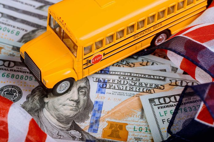 toy yellow school bus , US flag and dollar cash money