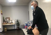 A-B-CPR owner Mike Long demonstrates proper CPR techniques on a mannequin during training for Oceanside Unified School District bus drivers in San Diego. (Photo courtesy of LeeAnn Conger.)