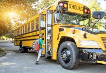 Children getting on schoolbus