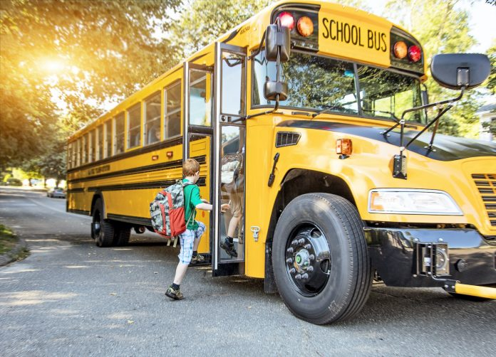 Children getting on schoolbus