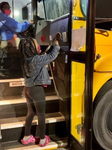 A Marietta City Schools student using a RFID card to scan onto the school bus. The district installed the technology for contact tracing amid the pandemic.