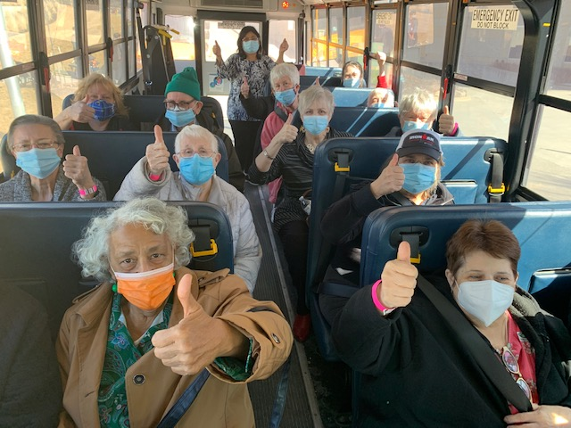 Clay County residents are transported to a vaccine clinic onboard a North Kansas City School bus. (Image courtesy of North Kansas City Schools)