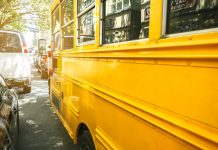 Closeup of classic yellow school bus parked on the street of New York City