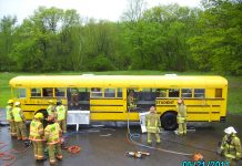Firefighters train using a school bus