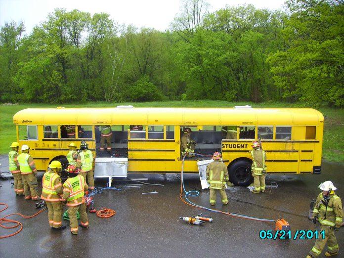 Firefighters train using a school bus