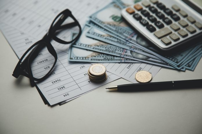 calculator and money on document on table