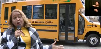 New York City Schools chancellor Meisha Porter shows off the first electric school bus that will begin transporting students next week.