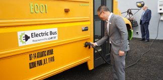 Vic Shao, CEO of AMPLY Power, plugging in the new electric school bus at New York City's ribbon cutting ceremony on June. 3, 2021.