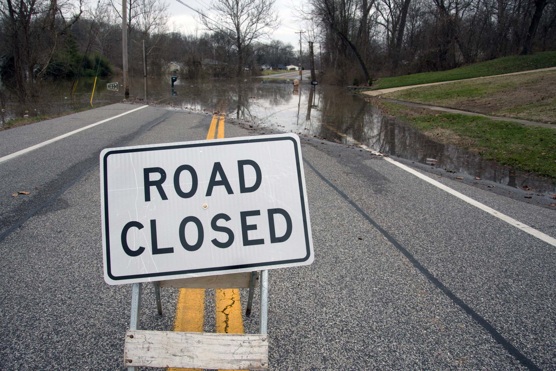A road closed sign in the middle of a roadway in Oakville near St. Louis, Missouri