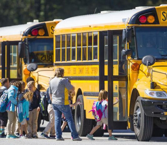 Students load South Bend Community School Corporation buses in Indiana. Prior to bell-time changes implemented in the spring, some buses ran one to two hours late each day. (Photo: Facebook/SouthBendCSC)